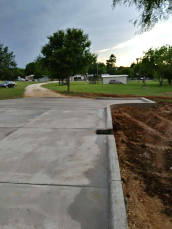 Finished concrete looking our from the parking area down the driveway.