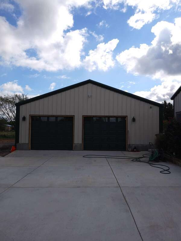 Front view of finished detached garage.