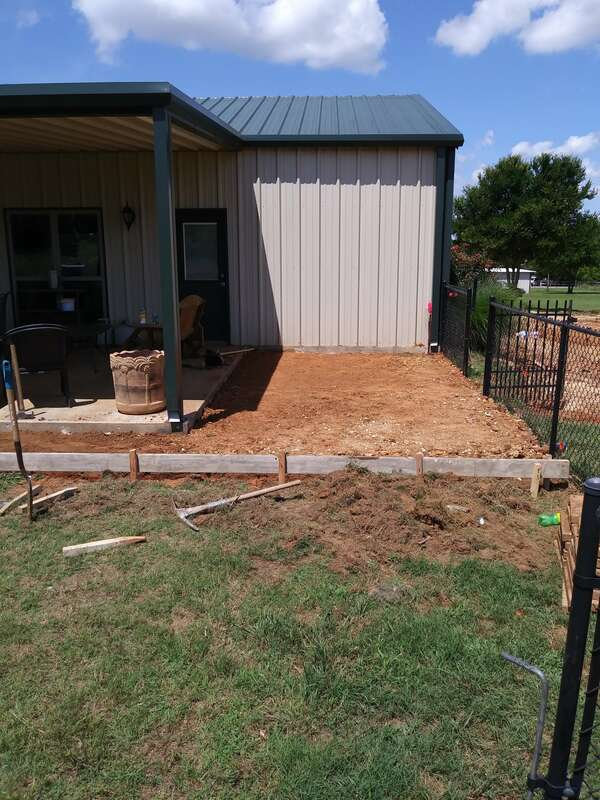 Concrete form boards set for patio addition.