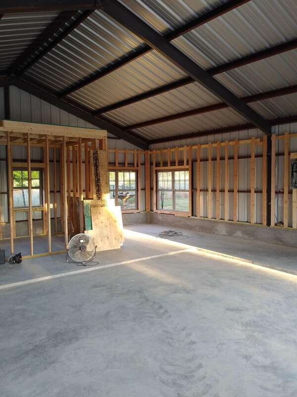 Exterior walls being framed with wood so we can sheetrock them.