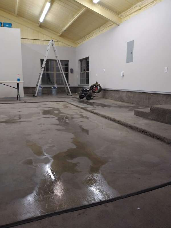 Pressure washer used to clean the floors.