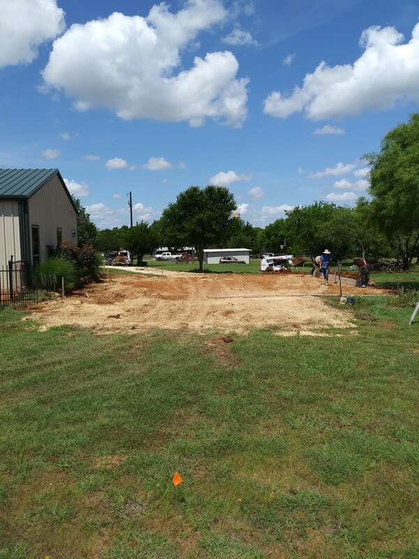 Dirt work started on the parking area to prepare for concrete.