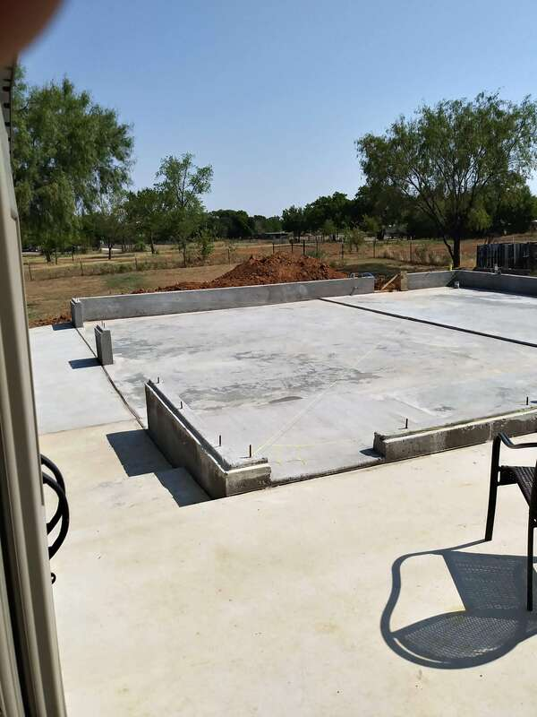 Another view of new garage concrete foundation from our patio.