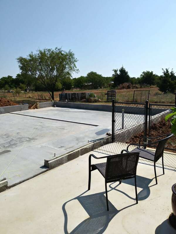 View of concrete foundation from our patio.