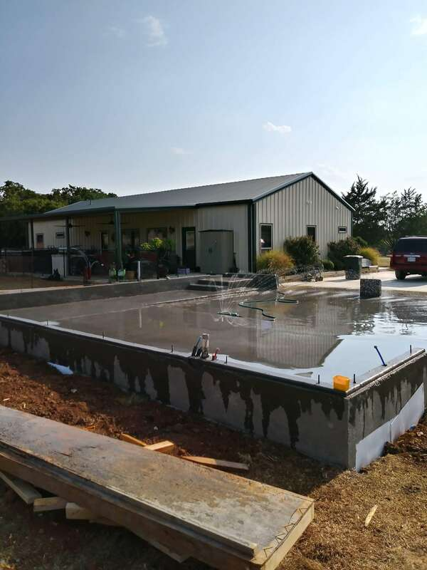 Slab on grade concrete foundation with stem wall completed.