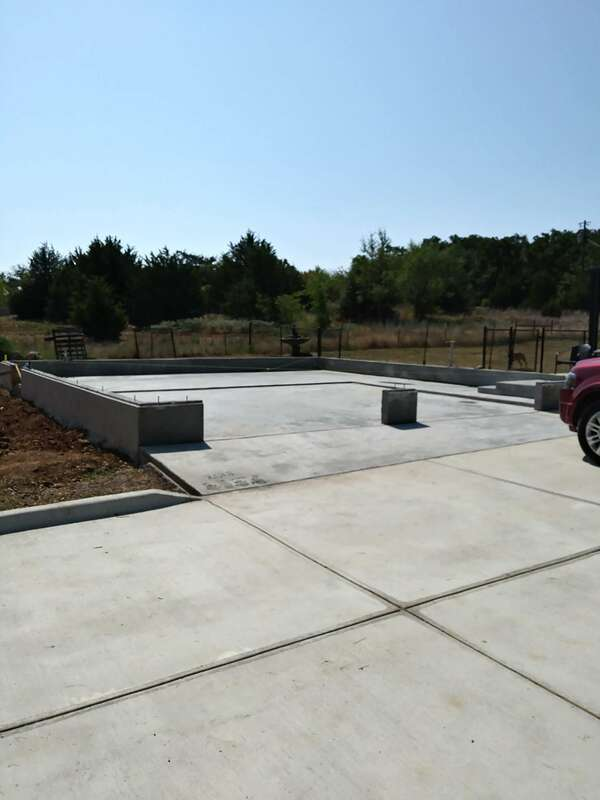 View from front of new concrete foundation for metal building.