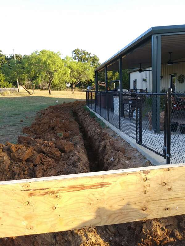 Trench for the electrical service to the new detached garage.